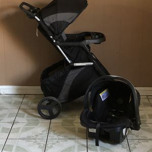 EVENFLO TRAVEL SYSTEM STROLLER AND CAR SEAT for Sale in Riverside, CA