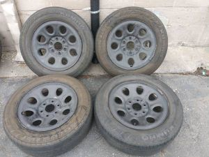 17 inch chevy or gmc steel rims and old tires. good rollers for Sale in Commerce, CA