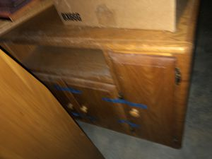Stand/ door on each end and in middle / shelf below top Oak for Sale in Winston-Salem, NC