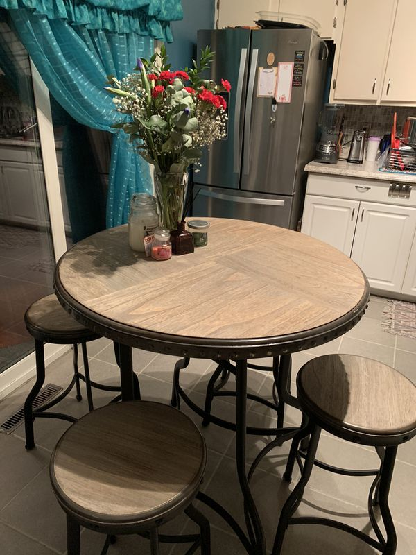 Table and 4 pub stools.