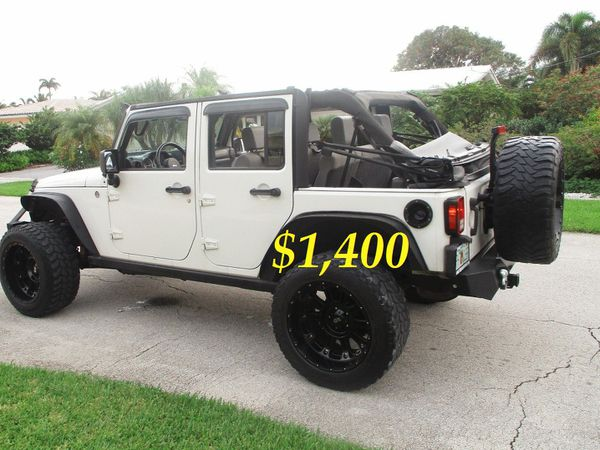 🍁$1,4OO FOR SALE 2010 JEEP WRANGLER 6 CYL 4X4 LIFTED WITH RIMS CLEAN.🍁