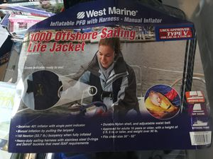 West marine offshore sailing life jacket and 1 onyx life jacket for Sale in Austin, TX