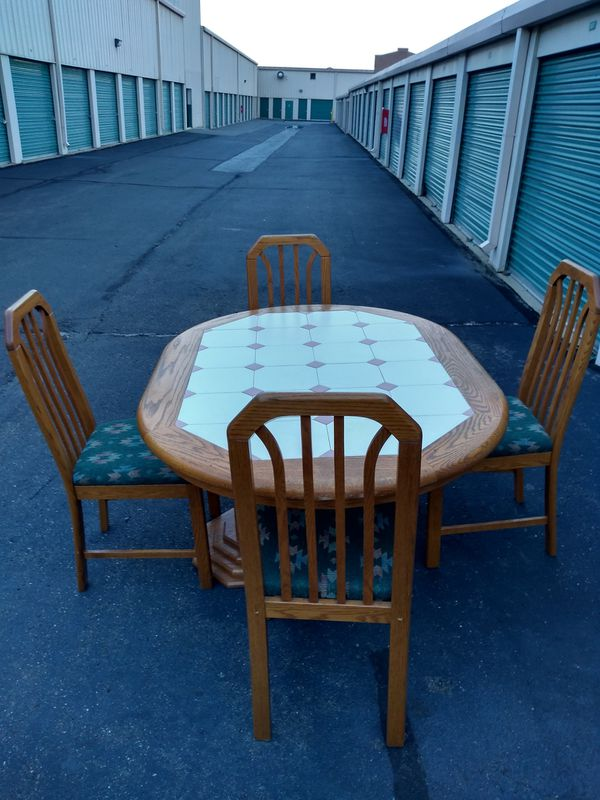 Designer dinette set sturdy with 5 very comfortable chairs and custom ceramic tile top excellent condition