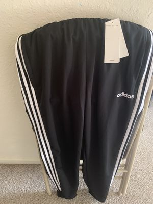 Brand new adidas pants size M color black never used for Sale in Tampa, FL