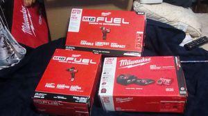 Three Millwakee M18 hammer drill, 5amp battery, 2 amp battery charger, m 12 hammer drill all for Sale in San Jose, CA