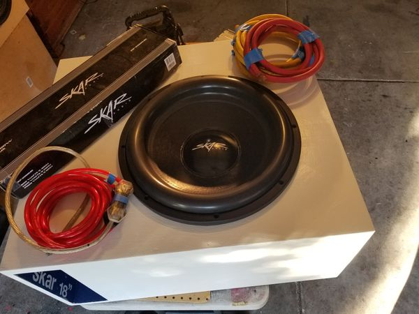 Skar zvx 18inch sub and a 2000 w RMS amp. Also, wires that you will need to run this setup. Sell with the possibly of trading.