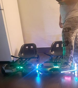 2 brand new hoverboards ,only used about 5 times all terrain, bluetooth connections for music, amd 2 hovercart attachments. Goes maximum 15 mph. for Sale in Scottsdale, AZ