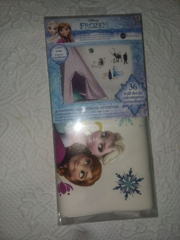Brand new never used never open Frozen wall decor.
