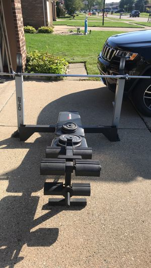 Bench press machine, bar, and weights for Sale in Sterling Heights, MI