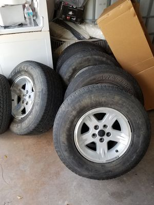 Jeep wrangler tj OEM wheels and tires for Sale in Tampa, FL