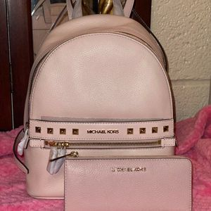 Michael Kors Pink Backpack and Wallet Set for Sale in Moreno Valley, CA