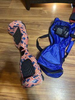 Hoverboard w/ bluetooth speakers and carrying case and charger for Sale in Zephyrhills,  FL