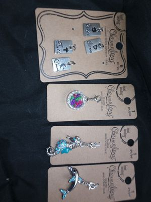 4 brand new never been opened charms very beautiful. for Sale in Phoenix, AZ