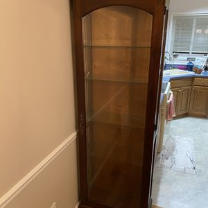Howard Miller Curio Cabinet for Sale in Gaithersburg, MD