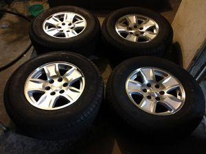 """Chevy Silverado 17"""" OEM wheels and tires 6x139.7 and 275/65/17 for Sale in Chino, CA"""