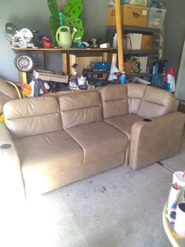 Tan leather couch and sectional