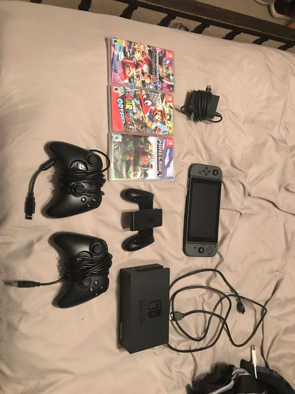 Nintendo Switch w 3 games and 3 controllers.