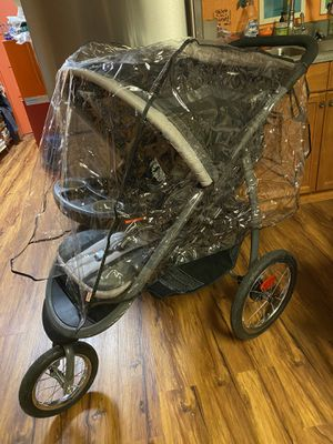Jogging stroller with plastic cover for Sale in Kent, WA