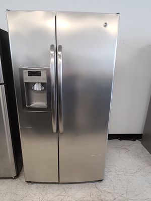 Ge stainless steel side by side refrigerator used good condition with 90 days warranty for Sale in Frederick, MD