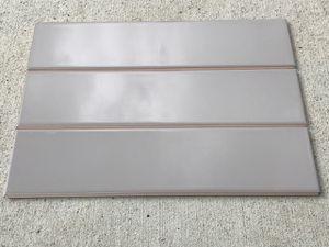 Tile backsplash 4x16 , 2 packs, 22 sf/ 50 pieces , light gray gloss for Sale in Auburn, WA