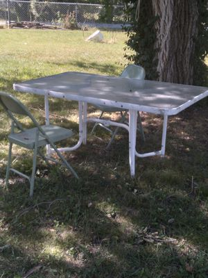 Outside table 2 fold up chairs for Sale in Andover, KS