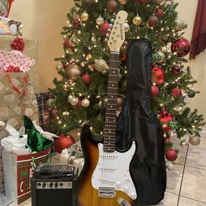 sunburst huntington electric guitar with case cable strap and amp for Sale in Downey, CA