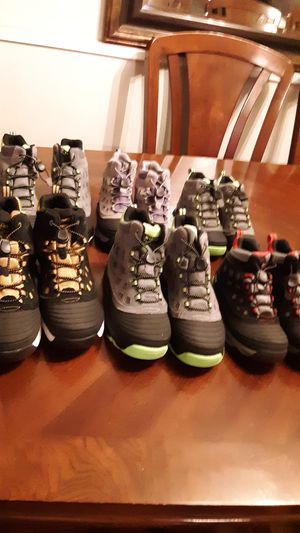 New Merrel kids Hiking Boots 2pairs size 5 two pairs size 2.50 one size 10.50$10.00 each pair for Sale in Montclair, CA