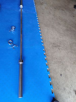 Olympic barbell and Olympic curl bar ..New.. for Sale in Renton, WA