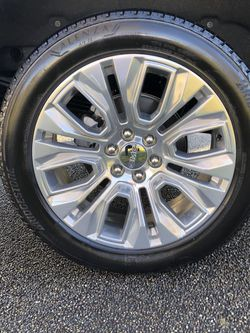 Like new 4 Bridgestone ALENZA 275/50R22 111T M/S tires..GMC 23 in Custom Wheels.. they are in EXCELLENT SHAPE for Sale in Olympia,  WA