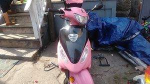 Pink scooter for sale .ONLY HAS 127 miles.want 700 or make a offer.Has many new parts. for Sale in Fall River, MA