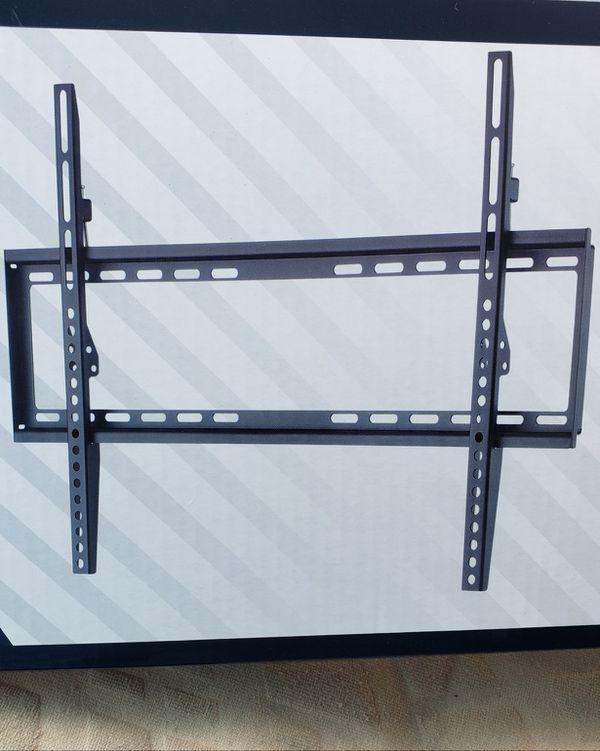 Tilt tv wall mount 22 to 70 inch $35 cash firm