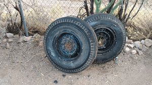 8 lug tires and rims the rims are split ring rims .cleaning my back yard and this needs to go first 40 $ takes them.good for a trailer or ? for Sale in Tucson, AZ