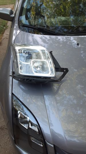 1st Gen Ford Fusion Headlight for Sale in Spring Lake, MI