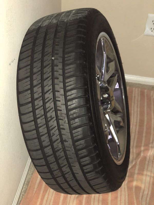 4 Michelin Pilot Sport tires along w/ chrome rims