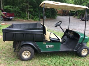 2006 easy go workhorse power dump bed two cylinder gas engine runs and looks great for Sale in Charlotte, NC