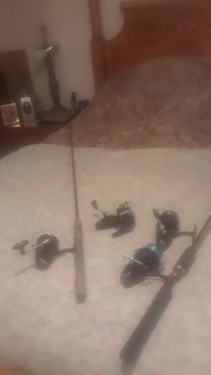 Fishing rods the name r Mitchell garcie for Sale in Strawberry Plains, TN