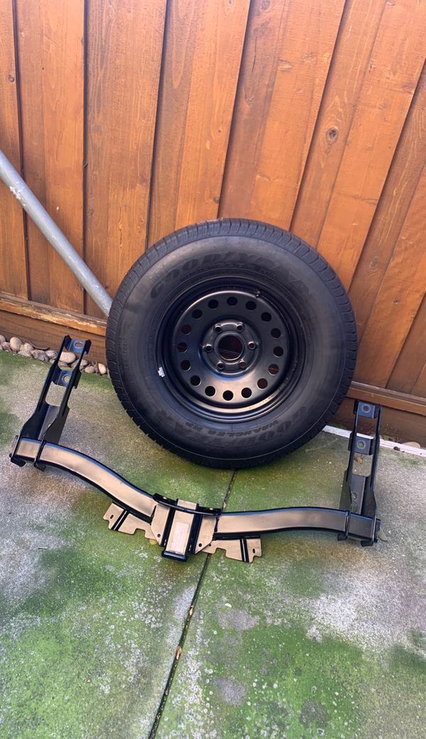 Trailer hitch and spare tire brand new