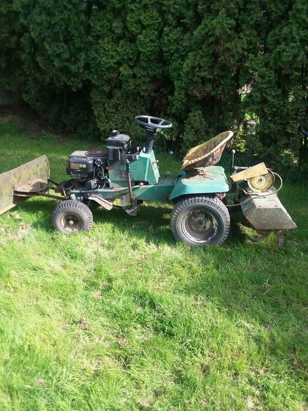 Garden tractor with tiller and blade runs good