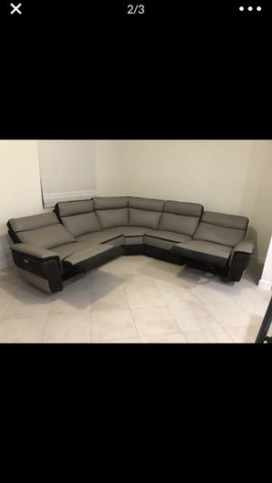High end Leather section couch electric reclining end. 1 year old Must sell moving for Sale in Riviera Beach, FL