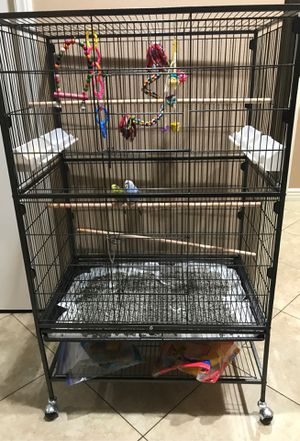 $200 obo Brand NEW cage too big for only 2 parakeets comes with wheels to doors and 4 feeding trays for Sale in San Diego, CA