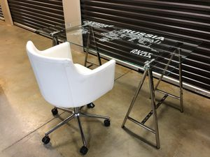 Glass Top Writing Desk and Chair Desk dimensions: 30.5'' H x 59'' W x 31.5'' D Have the world at your fingertips with this glass top home office desk for Sale in Lawrenceville, GA
