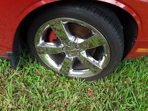 Rims and tires 20s 5×4 1/2 for Sale in Brooksville, FL