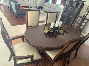 Adjustable Wooden dinning room table with 6 chairs for Sale in Miami, FL