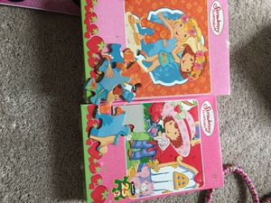 Strawberry shortcake puzzles and game!!! for Sale in Missouri City, TX