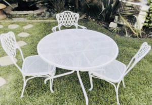 Antique iron table with 3 chairs for Sale in Los Angeles, CA