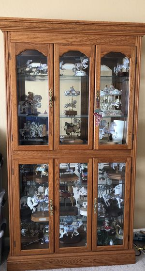 Cabinet and 15-20 Carousel Figurines / Music Boxes for Sale in Redwood City, CA