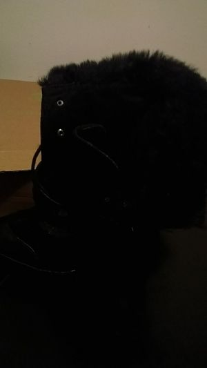 Black leather like booties heels with fur lining the inside size 10 for Sale in Richmond, VA