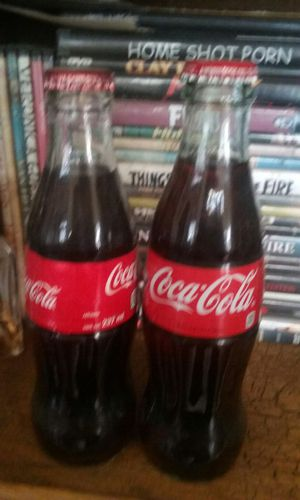 Two Collectible 8oz Glass Coke Bottles for Sale in Dallas, TX