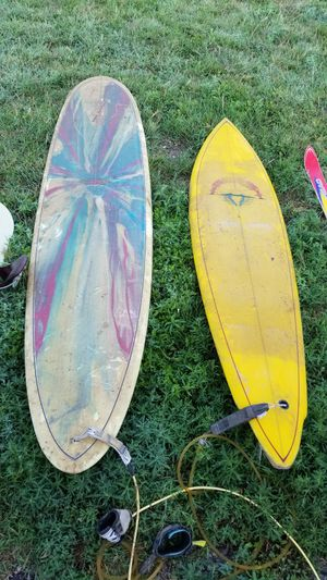2 surfboards...10 ft and the other is a six foot; both are set up for the old-school mono fin. for Sale in Brighton, CO