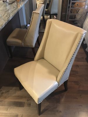 Pair of cream leather dining table chairs for Sale in Chicago, IL